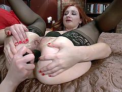 Redhead whore Violet always liked women just as much as men. Sarah is definitely her kind so Violet spreads her legs and keeps them up as Sarah plays with her tongue on Violet's tight anus. She slides her tongue and lips on that tight hole making the bitch moan with desire and then fills her up with an anal plug.