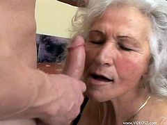 Get a load of this horny granny's big natural tits and her amazing ass in this hot clip where she's nailed by a horny stud.
