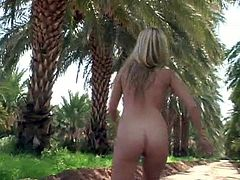 Alison Angel is shows off her flawless body when she gets fully nude near the beach and has some fun dancing in the warm sun.