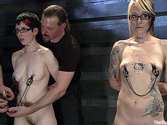 These slave women are lined up in a row and ready for some weight torture. The master attaches chains to all the girl's nipples. Next come the steel weights. They have to stand up straight and not arch their back or the master will not be pleased.