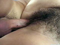 This dirty-ass bitch gets her hairy pussy fucked hard by a fucker who loves bitches with a full bush. Hit play and watch him stick it in that hairy pussy!