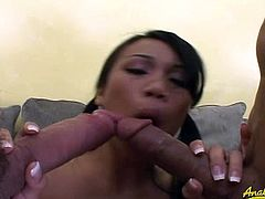 After sucking both cocks, Luci Thai takes one cock in her pussy too. While riding it, she's sucking the other one.