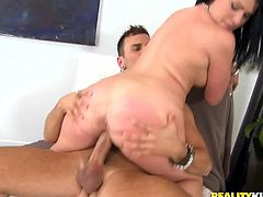 Share this with your friends! A brunette, with giant gazongas and a nice ass, gets her pussy destroyed by a kinky dude and moans loudly.