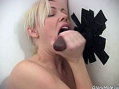 Adrianna Nichole sucks on a big cock in gloryhole scene