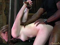 Oh, is it to rough for her? Well she should have thought about this when she said she wants a bdsm! Mattie thought it will be fun but when she found herself secured in that bondage device and bent over she understood what she got herself into. To make things easier for her a big black executor comes from behind...