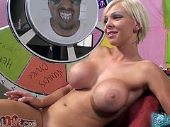 Nikki Monroe has huge fake boobs which look unnatural and ugly. Bitch laughs while one dude finger fucks her shaved meaty snatch.