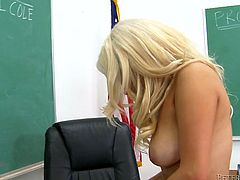 Gorgeous blonde sex bomb Cami Cole shows off her big boobies in the teacher's office. check out how she its on teacher's desk all naked stroking her udders and long legs.