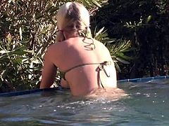 Sexy blonde chick Alison Angel is having fun on the bank of a river. She bathes and then takes her bikini off and demonstrates her jaw-dropping natural boobs.