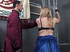 Danielle gets tied up and has her skirt lifted up so her master can use the paddle to turn her sweet, round cheeks red as he spanks her.