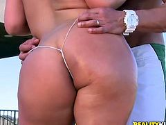 Check this blonde chick, with big knockers wearing a thong, while she goes hardcore with a lusty man over a couch and moans loudly.