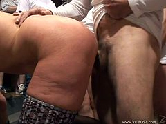 Watch this hot scene where this horny granny is fucked by a massive amount of guys as they all take turns gangbanging her.