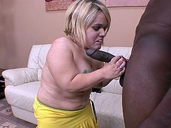 This is the craziest sex combo you have every seen in you entire life. The blonde midget is barely 3 feet tall while the black hunk is nearly 7 feet tall. She get her deformed tits sucked and then she sucks on his massive dong. She doesn't even have to kneel down to suck his cock.