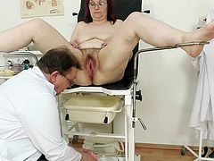 Watch how her hairy twat gets stretched during full gyno exam