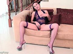 Purple lingerie looks hot on masturbating ladyboy