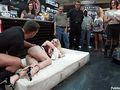 Handcuffed and with metal clamps hanging on her pussy the blonde is putted to crawl and then lick this guys shoes. She's humiliated and shocked with an electric wand. All that playing was nice but the men are staring to loose their patience and the real action begins as she is putted on that mattress and fucked hard
