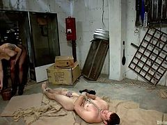 This pathetic sex slave is tied up in rope and left to wallow in his own filth in Lorelei's garage. She teases him but he can do nothing because his cock is locked up. She steps all over him and puts clothespins on his mouth.