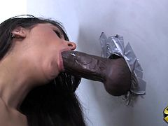 Get a boner watching this long haired brunette, with natural boobs and a shaved love tunnel, while she has interracial sex in a gloryhole.