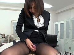 This sexy secretary goes the extra mile to make certain her boss is happy by sucking and stroking his cock in his office.