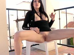 A beautiful brunette sits down on a chair and lifts her dress up. Aiden shows her pussy and fingers it. Then she takes a dildo and starts to push it deep in her vagina.