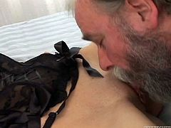 Svelte red haired honey in sexy black corset was watching porn when old bearded guy joined her. After getting her tight coochie eaten babe gave blowjob to her fat partner and rode his junk in reverse cowgirl pose.