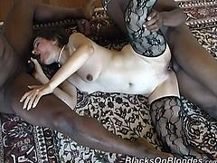 Lewd dark-haired milf Sheri-Lynn is having fun with two black dudes indoors. She sucks and rubs their schlongs and then gets her pussy torn up.