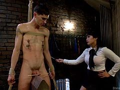 Sal is bound with rope so he can't run away from this cruel Asian mistress. She whips his pale body and the red marks show up immediately. The nipples clamps attached to him give him even more pain and she humiliates his pathetic cock.