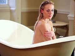 Cute blonde Becky Roberts is having a Playboy photo shoot in a bathroom. She soaps and strokes her nice natural tits and seems to enjoy herself.
