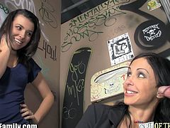 Out of the Family brings you a hell of a free porn video where you can see how an alluring brunette Milf and a kinky teen suck a hard rod of meat cock through the glory hole.