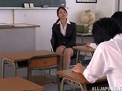 Cute Japanese teacher Chika Kitano wearing pantyhose is having rest during a break. She rubs her pussy ardently and also plays with a vibrator.
