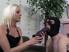 This slutty girl pushes a huge dildo in guy's mouth. A White guy in a mask sucks a big black dildo. After that Kacey gives a blowjob to a Black guy. She gets fucked deeper and harder than ever before.