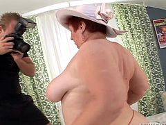 Take a look at this hardcore scene where this horny granny gets fucked by a horny guy as you have a look at her big natural breasts.