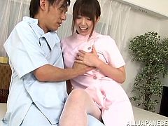 Pretty Japanese girl Ruka Kanae wearing pantyhose and a nurse uniform shows her nice natural tits to some guy and lets him knead them. Then she massages the guy's boner with her feet and moans with pleasure.