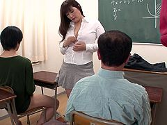 Instead of learning their math problems this sexy Japanese teacher catches her male students masturbating in class. She decides the best plan of action is to help them out so she does a striptease so they have some inspiration. She plays with her pussy and lets the students grab at her big boobs. But now she needs to suck them off so they can focus again.