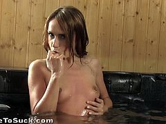 This sexy girl was swimming around in the hot tub pool when she went to edge and throated her man's cock until he came.