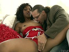Watch the sexy cheerleading ebony babe Lotus Lain sucking on this guy's big white cock before he pounds her wet pussy.