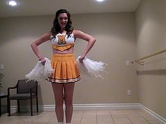 Holly does a dance and shows off her moves to her boyfriend. Her seductive ways really turn him on and before long his dick is bulging out of his jeans. She will take care of that. Look as this cheerleader chick undoes his belt and licks his cock and balls.