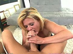Fluffy light haired bitch Ginger Lynn takes massive dick up her mouth balls deep till tears start falling from her eyes. Bitch chokes but still holds that fat dick in her throat balls deep.