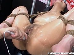 Femdom Bride brings you a hell of a free porn video where you can see how an alluring Asian brunette gets tied-up and vibrated into heaven while assuming very hot poses.