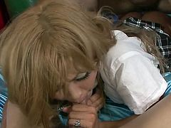 This kinky Japanese slut lays on the bed and lifts up her skirt, so she can get fucked super hard. She wraps her luscious lips around one of the guy's cocks and the other man, fucks her tight pussy hole like mad.