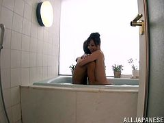 Reiko Sawamura shows her nice boobs while taking a bath. This cheerful Japanese woman gets oiled up and then fucked from behind in a standing up position.