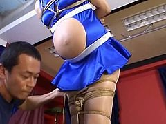 Yuri Matsushima is a hot Asian MILF who is a sexy racequeen. She is tied up in her short skirt with her hands and feet tied. Her guy cuts the cloth over her tits and he is playing with her nipples to make them squirt milk because she is lactating and he enjoys the act of milking her tits. Yuri Matsushima is an amateur but she is quickly learning about bondage and pleasure.