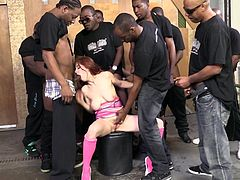Insatiable redhead bitch Maddy Oreilly is having fun with some black dudes indoors. She sucks and rubs their pricks devotedly and gets cum on her face.