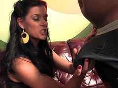 Have fun watching this brunette MILF, with a nice ass wearing high heels, while she goes really hardcore with a big black cock over a leather couch.