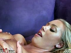 Stunning beauty Nicole Aniston gives great titjob with her nice tits. The her man fucks her shaved cooch from behind on the couch.