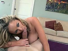 Sexy blonde Katie Kox is pleasuring horny stud with an explicit titty job