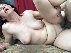 Take a look at this hardcore scene where this horny redhead granny is fucked as you hear her moan while riding this man's hard cock.
