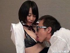 Salacious Japanese chick is playing dirty games with her boss indoors. She favours the man with massage and then they have sex in missionary position.