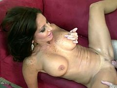Raunchy mom with big fake boobs bounces her booty while riding hard stick in cowgirl position. She then gets nailed in a missionary position before taking doggy position.
