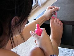 Aurora pulls off her cute socks and shows off her pretty feet then she gets naked and spends some time painting her toenails.