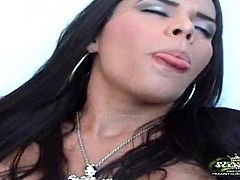 Passionate dark-haired tranny called Labely shows her cock-sucking skills to some guy. Then she sits down on his cock and they have sex in cowgirl position.
